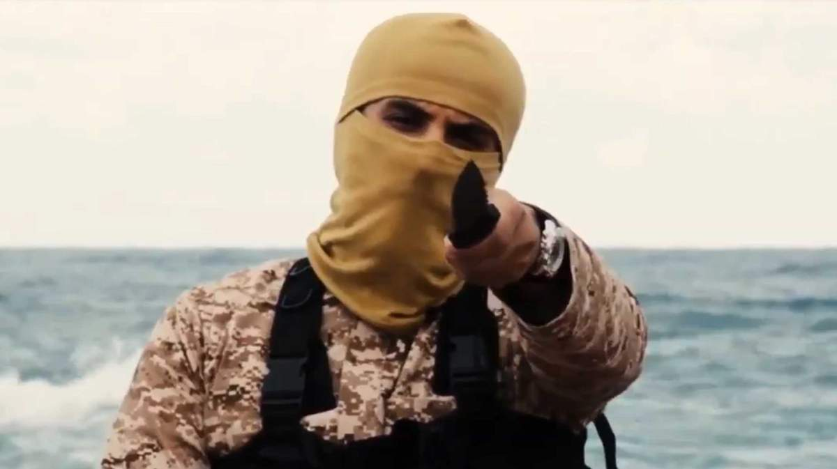 February 15, 2015 - Libya: A group of 21 Egyptian Christians, who were seized by ISIS fighters while working in Libya, shown in a new video before they were purportedly killed. ISIS (Daesh), also known as ISIL, released a video claiming to have killed 21 Egyptian Christians who were captured in Libya. The Egyptians were wearing orange jumpsuits, being forced to the ground by militants dressed in black, and beheaded on a beach. The five-minute video had a caption that read, 'The people of the cross, followers of the hostile Egyptian church.' The video first appeared on the Twitter feed of a Daesh sympathizer's website. Daesh claimed to have captured the Egyptians in Sirte in January. Before the killings, one of the militants stood with a knife in his hand and said: 'Safety for you crusaders is something you can only wish for.' The 21 men, all migrant workers hailing from impoverished areas of central Egypt, were kidnapped between late December and early January. Fourteen came for the same village, Al-Our. (News Pictures/Polaris)