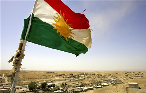 A Kurdish flag waves from the top of a new watertower built by the Patriotic Union of Kurdistan political party Monday, Aug. 15, 2005 in the village of Shwan, outside Kirkuk, Iraq. Since 2003, there has been a steady influx of Kurdish returnees to the area around Kirkuk leading to the rebirth of villages such as Shwan, reversing Saddam Hussein's decades long policy of Arabization. (AP Photo/Jacob Silberberg)